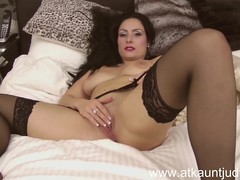 Sophia Delane is erotic in her lingerie and stockings.