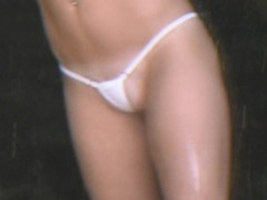 MILF gets wet insusceptible to the beach in the brush thong bikini