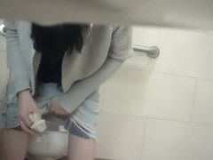 The amateur fem was snowy pissing on spy camera. She is crippling the candid tiny shorts that on touching don