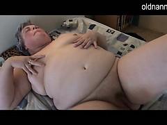Fat granny masturbating near long black dildo