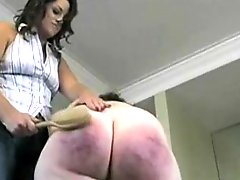 Painful spanking for BBW brunette