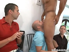 Sexy youthful man engulfing stripper dick at party