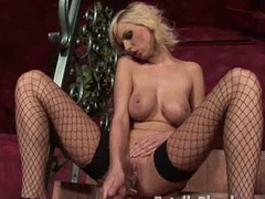 Busty peaches babe in fishnets fucking a substantial glass dildo on make an issue of couch